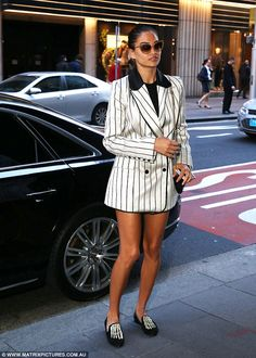 Daring! The brunette stunner showed off her sculptured pins by wearing a short striped coa...