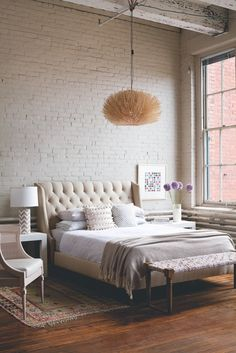 Neutral Bedroom And Exposed Brick