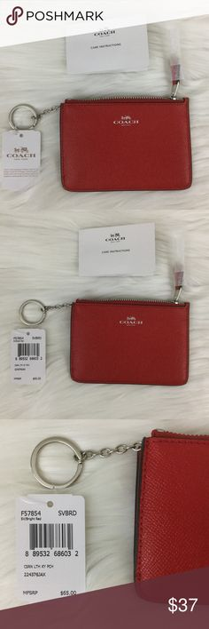 """Coach Red Leather Key Pouch in Crossgrain Leather Bright red Genuine Coach zip Key Pouch in crossgrain leather.  It has silver colored accents (zipper and Coach logo).  NWT in original packaging from Coach.   *2 Credit Card Slots  *Zip-top Closure  *Fabric Lining  *Measurements: approx 5""""L x  3 3/4""""H Coach Bags Clutches & Wristlets"""