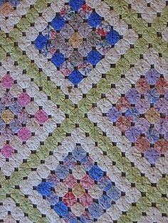 Yo Yo quilt - I'm working on one of these. So cheerful! :)