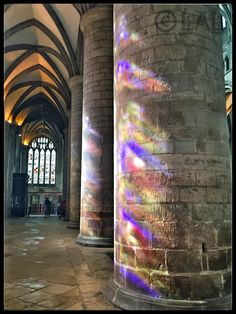 Sunlight through the stained glass windows at Gloucester Cathedral lighting up the columns #photo #photography #Gloucester #cathedral #colour #glass