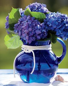 Blue glass pitcher and purple blue hydrangea #flowers #floral