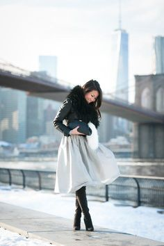 A classy look from NYC: grey full skirt and a faux fur collar.