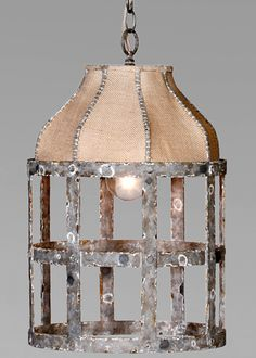 Gabby Lighting Lucia Chandelier. modeled after a vintage dress form; round cage-like frame constructed from oxidized iron, topped w/ burlap. $623