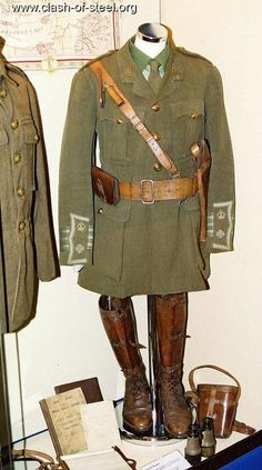 WW1 BRITISH OFFICERS UNIFORM. Showing brown belt, compass, pouch, sword hanger, pistol holster, boots and binoculards.