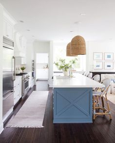 Bistro stools and hanging pendants complete this beautiful kitchen Home Kitchens, Sweet Home, Kitchen Inspirations, Edwardian House, Charleston Homes, Bistro Stools, Kitchen Dining, Home Decor, Hamptons Beach House
