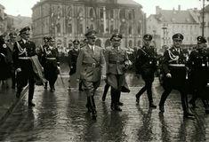 Hitler and Himmler in Weimar, 1938. Hitler's valet, Karl Wilhelm Krause is carrying the Fuehrer's coat.