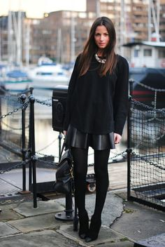 Zina Charkoplia in London wearing all black
