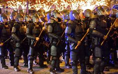 Atlanta police in riot gear help keep protesters moving down Peachtree Street in Atlanta in the wake of the grand jury decision not to indict officer Darren Wilson in the shooting death of Ferguson, MO., teen Michael Brown.