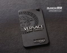 This is a high-end designer tag. It's got the original logo and style to it, although the minimal colours don't fit with the designer's clothing. This might be because black will stand out against the clothing.  The text has a 3D element to it, and the imagery looks embossed. This would be more expensive to make.