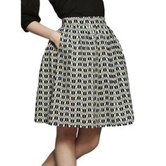 Love this MadeFair skirt for work: http://madefair.co/collections/bottoms/products/organic-cotton-puffin-print-skirt