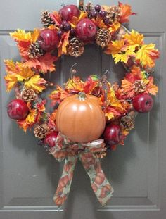 Autumn wreath with faux apples, leaves, small pumpkin, hand glittered pine cones, pumpkin ribbon.