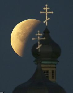 BELARUS: The supermoon shone through the night over an Orthodox church in the eastern Euro...