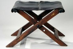 Washington ordered camp stools in 1776 through Plunket Fleeson, who made his first set of marquees.    The invoice read:  To 18 wallnut camp stools, Moreen, brass nails, girth, tacks & bottoming. @15/13/10    The seat on this original has been replaced with leather. The originals used moreen, a watered worsted wool.