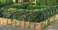 This aluminum garden fence adds a decorative touch to flower beds and keeps plants where you want them. Rust-free and lightweight, each section is finished with a durable black paint. 4720 Aluminum Garden Fence (Set of Four) Dimensions: Fence Landscaping, Backyard Fences, Garden Fencing, Landscaping Software, Yard Edging, Brick Edging, Metal Edging, Brick Fence, Brick Border