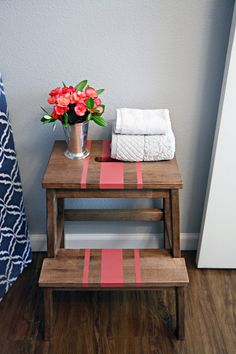 Use an IKEA step-stool to give your kids a boost and store decor and hand towels.