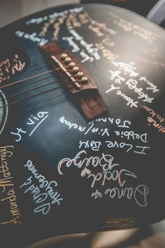 Guitar as wedding guest book. Then hang on wall of home as decoration.