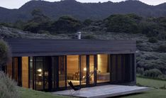 Fearon Hay Storm Cottage Great Barrier Island series of framed, narrow glass panes: Remodelista