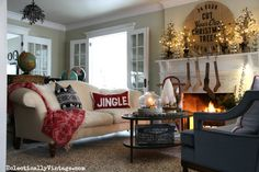 Cozy Christmas living room - love the accessories - part of this gorgeous Christmas home tour eclecticallyvintage.com