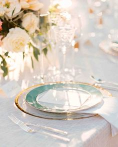 The Prettiest Place Settings from Real Celebrations | Martha Stewart Weddings – These seafoam-hued plates sat pretty atop clear, gold-rimmed chargers.
