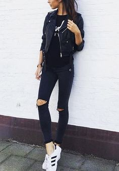 Create a rock chick look with this black ripped skinny jeans. It features button and zip fly and five pocket design for a classic style. Shop it here. | Lookbook Store Street Style