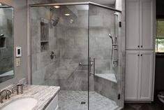 Gray Tiled Shower with Glass Shower Door and Brushed Nickel Hardware Gray Shower Tile, Brushed Nickel Hardware, Double Vanity, Glass Shower Doors, Residential, Shower Doors, Custom Door, Grey Tiles, Bathroom Shower