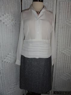 This is another ensemble from Doncaster's 8 GR8 Style Pieces. Includes: White Blouse, Suit Skirt and necklace.