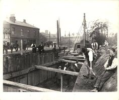 Re routing the canal on Barton Rd during the demolition of the old stone aqueduct. Circa 1891