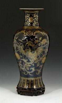 19th century porcelain vase, China, with mirrored black glaze, decorated with gold phoenix, on wood base