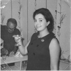 17th September 1964 - my 21st birthday. Pregnant and nauseous but still managing the champagne! My father in the background pouring drinks at the ultra trendy drinks bar in our sitting room. Padded white plastic front if I recall correctly...