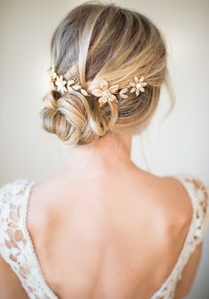 This beautiful gold tone hair vine is a lovely finishing touch for the boho chic bride. A mix of crystal and warm gold tone metal flowers are accented with crystal encrusted leaves. Three crystal flowers have a center pearl. All set on a bendable wire so it may be placed many ways in your hair. Measures: 10 long x 1.5 tall (largest flower) with wire loops on each side to attach with bobby pins or ribbon ties.  Choose from Bright Gold tone or Brushed Gold tone (see last photo).  HOW TO WEAR…