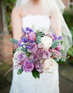 Beautiful Bouquet Composed Of Large Ivory Rose Blooms, Lavender Roses, Purple Poppies, Bi-Color Pink & Hot Pink Roses, Lavender, Purple Astrantia, Pink Astilbe, & Baby Eucalyptus......