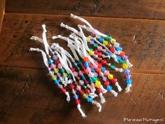 Bead slides can help your students with phonemic awareness! Instead of shoelaces, I will use pipe cleaners and pony beads.  Students slide a bead over for each sound they hear in a word - segmenting.