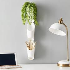Umbra FLORALINK WALL VESSELS can be used for planters or regular storage. Wall decor that can be placed in any room, these fun storage solutions make decorating and organizing extra fun. Photo by Pottery Barn Teen College Room Decor, Decor Room, Bedroom Decor, Flora, Plastic Planters, Dorm Walls, Teen Decor, Desk Supplies, Pottery Barn Teen