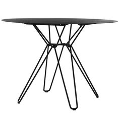 Tio dining table by the Swedish Massproductions has a round table top in metal…