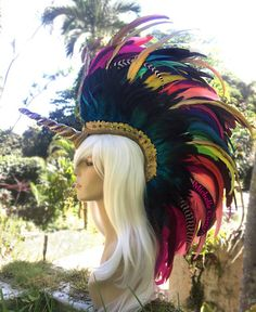 Rock out with your hawk out and feel like a God/Goddess in your one of a kind, 'MADE JUST FOR YOU feather mohawk!!! Made with Aloha <3 READ BEFORE PURCHASING **This piece is made to order. The piece in this photo has been sold. Depending on the time of year, Please allow 2-8 weeks or