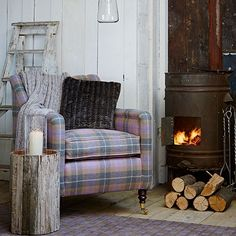 Rustic living room with checked armchair | Living room decorating | Country Homes & Interiors | Housetohome.co.uk