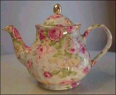 "Chintz teapot by Arthur Wood of Staffordshire, England. It is the six cup size and it stands 7"" tall to the top of the finial. It is 9.5"" wide from the tip of the spout to the side of the handle."