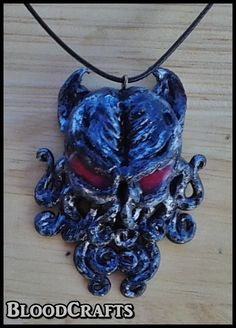 Handmade Cthulhu Lovecraft Octopus red eyes pendant by BloodCrafts