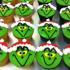 1001 + Ideas for Tasty and Beautiful Christmas Cupcakes : holiday cupcakes, a batch of chocolate and vanilla cupcakes, with green and red fondant icing, decorated with yellow black and white frosting Grinch Christmas Party, Christmas Snacks, Christmas Goodies, Christmas Baking, Xmas, Grinch Party, Diy Christmas, Christmas Cupcakes Decoration, Holiday Cupcakes