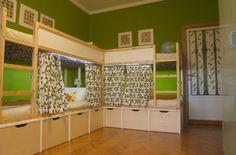 Ikea Kura beds on a custom platform.