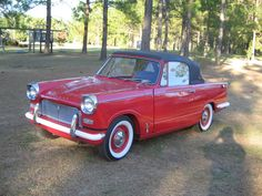 '66 Triumph Herald convertible. Saw one of these when I was taking a walk the other day!