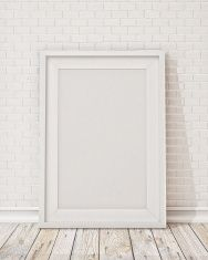 blank white picture frame on the wall and the floor stock photo