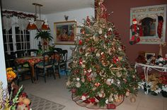 Burlap plaid Christmas tree theme - decor includes even poinsettia plants with these colors