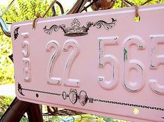 Paint a  license plate and stencil as vintage cottage style home decor; upcycle, recycle, salvage, diy, repurpose!  For ideas and goods shop at Estate ReSale & ReDesign, Bonita Springs, FL