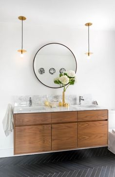 Mid-Century style bathroom with a round vanity mirror, designed by MHouse Interiors and photography by Stephani Buchman, via @sarahsarna.