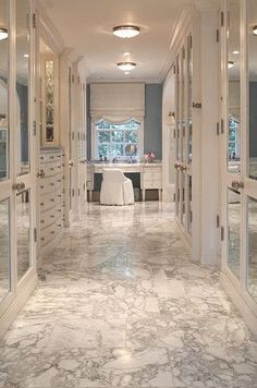 Glamorous marble dream closet by David Phoenix.. love it, interior design ideas, mirrored fronts, dressing table, organizing ideas, home decor