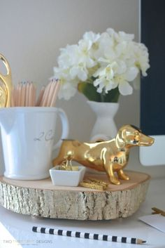 Declutter your desk with this elegant (and rotating) wood slice.  Get the tutorial at All Things Thrifty.   - CountryLiving.com
