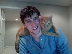 dark hair, blue eyes and a cat lover... does it get better than that? hahaha