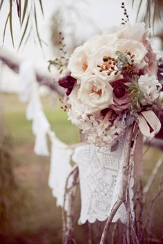muted autumn bouquet with lovely lace bunting... great for walking down the aisle.